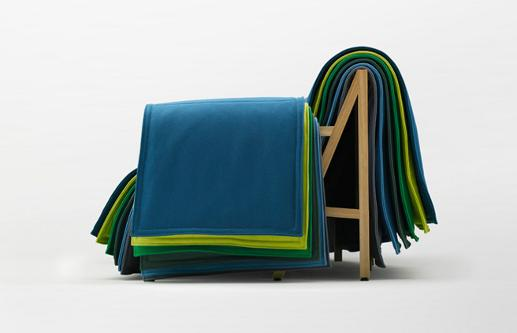 Flio Sofa for Cappellini is covered by Layers of colourful textiles, which the owner has the opportunity to change