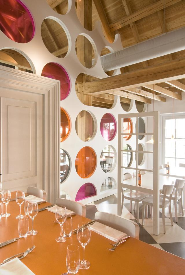 Wood and colorful elements are commonly used in the interior