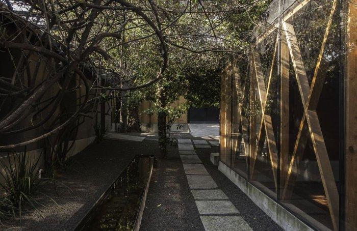 Glass Facade - Modern Bodywork Center Architecural Design in Mexico