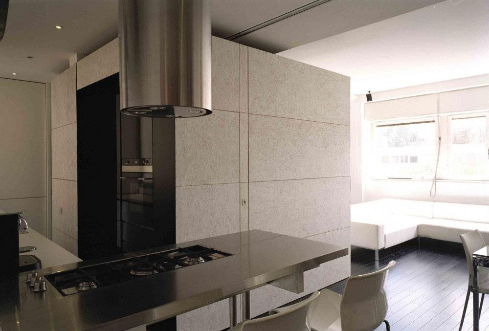 The kitchen perfectly matches the rest of the apartment interior design.