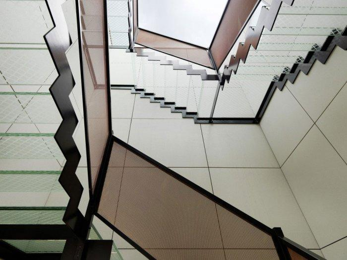 The boathouse staircase – modern luxury boathouse design by the lake.