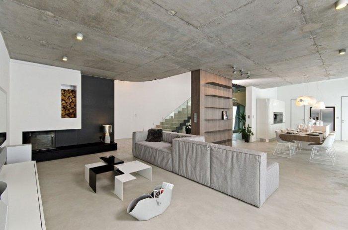 Contemporary Living Room - Concrete as a Global Apartment Interior Design Trend