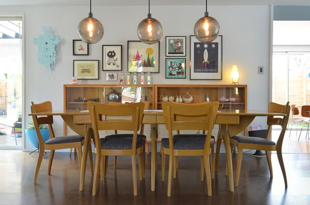 Dining room with table and six chairs and wall photos - Eclectic Dallas Home with Mid-Century Interior Design
