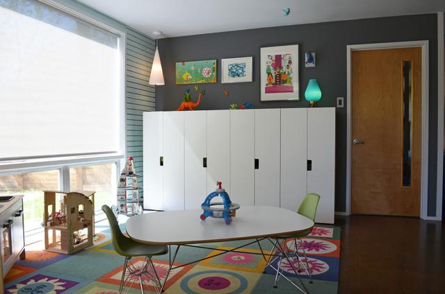 The kids room with a table and chairs in the middle and toys spread around - Eclectic Dallas Home with Mid-Century Interior Design