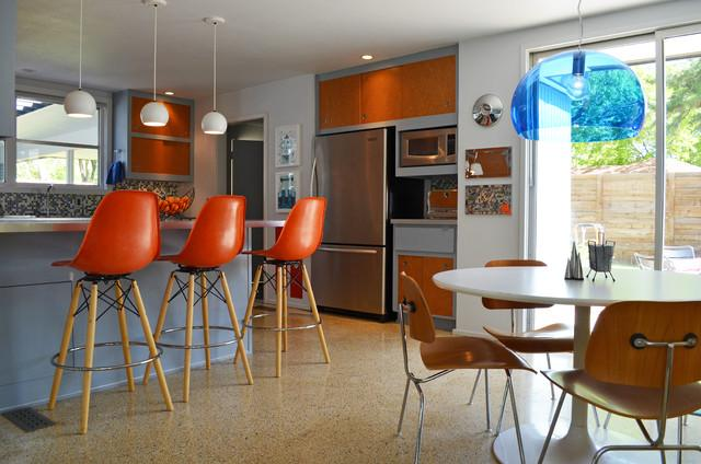 The kitchen area with some bar stools - Eclectic Dallas Home with Mid-Century Interior Design