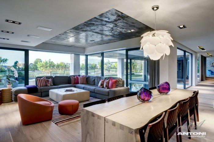 Luxury dining table with a view to the living room furniture - Contemporary and Luxury House Interior Design in Cape Town