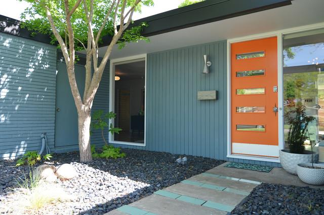 The main entrance and its orange door - Eclectic Dallas Home with Mid-Century Interior Design