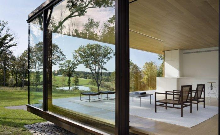 The glass facade of a modern house - Amazing Sustainable House Architecture and Design