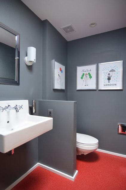 Modern toilet with grey walls and printed images on them as decoration- Eclectic Dallas Home with Mid-Century Interior Design