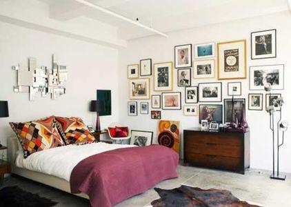 Pictures hanging on the wall of an eclectic bedroom - Arranging them as Home Decoration