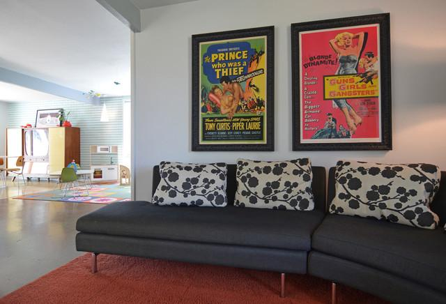 Pop art posters are hanged above the sofa - Eclectic Dallas Home with Mid-Century Interior Design