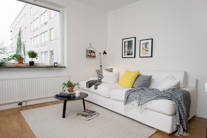 Scandinavian living room design and white sofa in Gothenburg