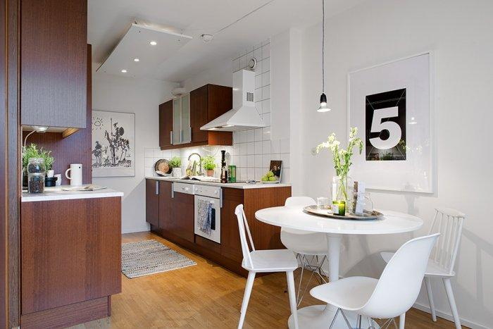 A view towards the open kitchen and the dining area - Scandinavian Small Apartment Interior Design in Gothenburg