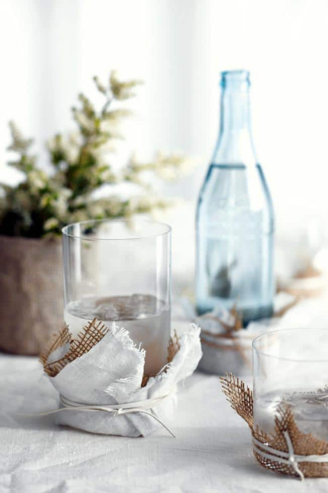 A decorative glass of water on a table - How to Decorate Your Table for Lunch - Tips