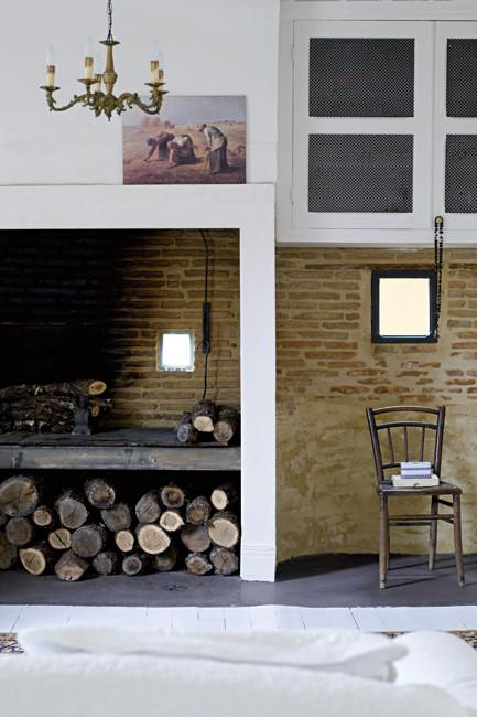 Amazing open fireplace - Rustic French Country Home Interior Design in Paris