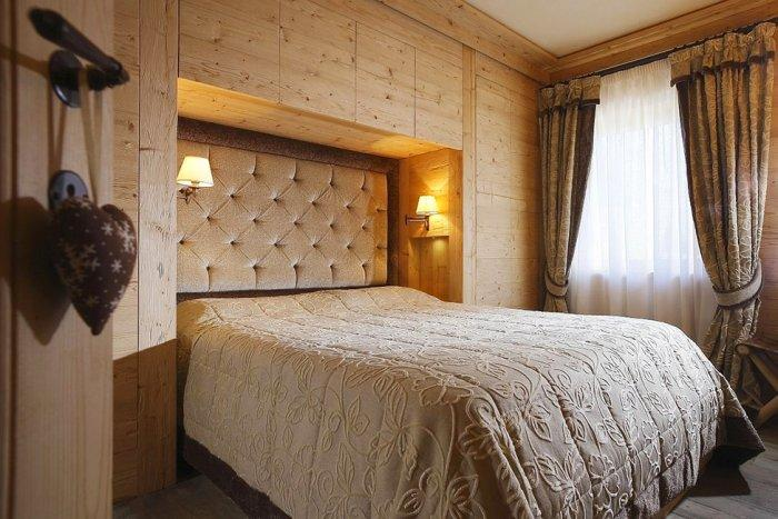Bedroom with wooden walls - Wooden interior design of an apartment in a rustic style