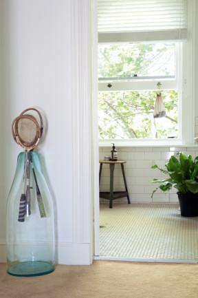 Big glass decorative bottle- Elegant Small Apartment Interior Design in Victorian Style