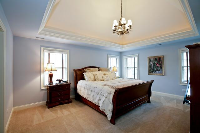 Blue bedroom and a massive wooden bed - Color Ideas for Healthy Sleep