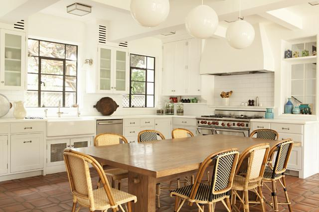 Comfortable pillows used on the chairs at the dining table - Low-Budget Ideas and Ways To Bring the Summer into your Kitchen