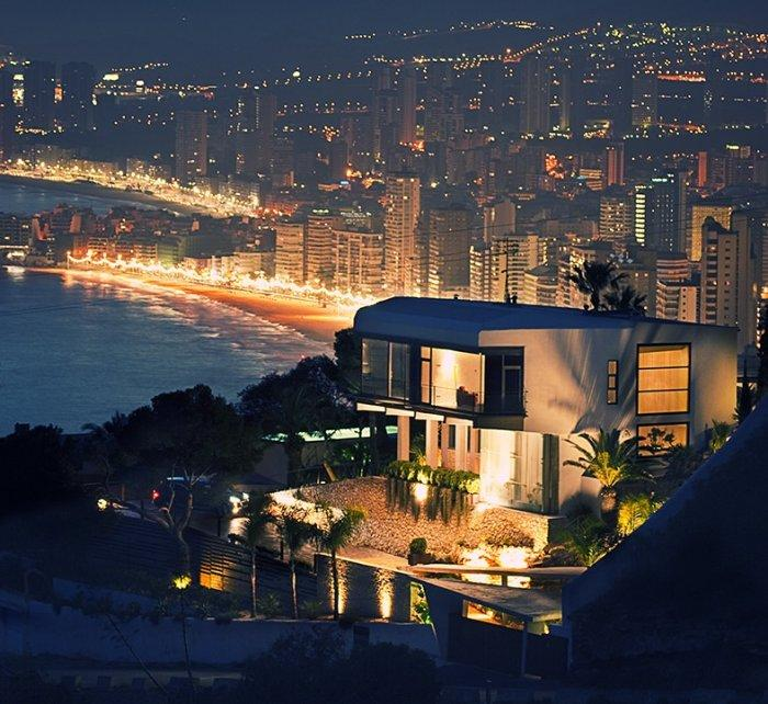 Contemporary house architecture by night of a Coastal House in Spain