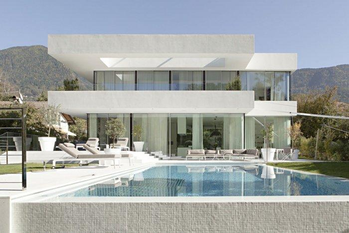 Contemporary two story house with swimming pool in front of it - Contemporary House Architecture of a Home in Milan, Italy
