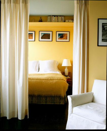 Cozy bed and wall decorations hidden behind a curtain - Color Ideas for Healthy Sleep