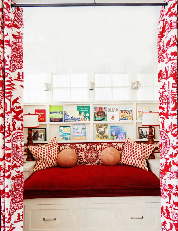 Decorative cushions on a bed with red cover - Small Room Ideas - Interior Design and Decoration
