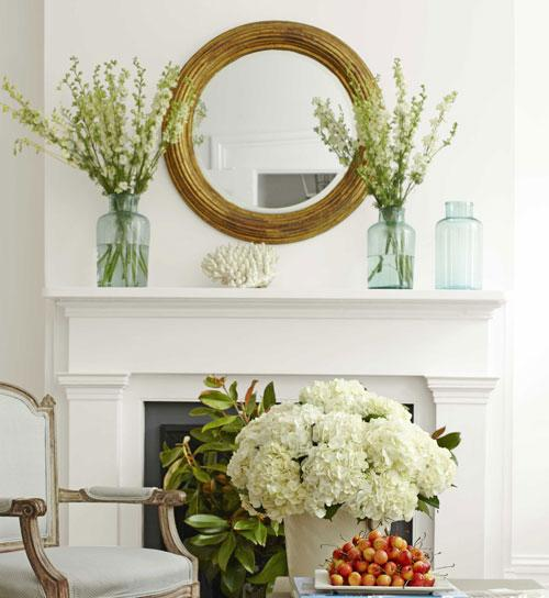 Flowers everywhere – on the coffee table, in the fireplace and above it - Home Interior Decorating Tips - 6 Easy to Follow Ideas