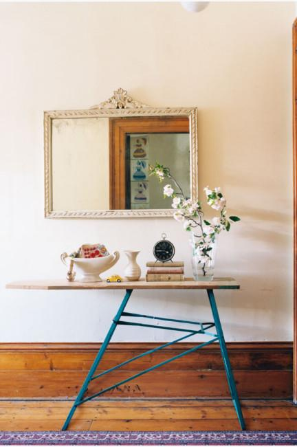 Ironing board with decorative flowers, a clock and some pots on it - Home Decoration Ideas for your Favourite Rooms