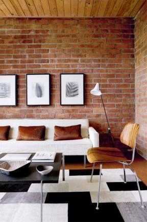 Modern architecture includes brick wall in the interior - Dream Beach House in Miami