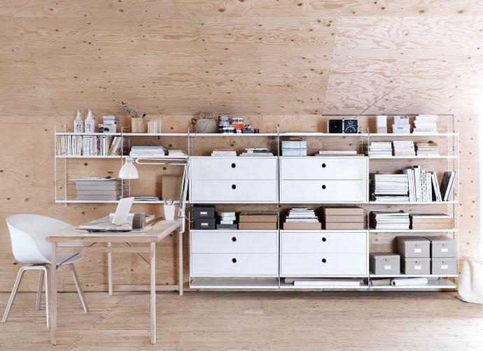 Modern shelves placed next to a working desk Completing the Furniture