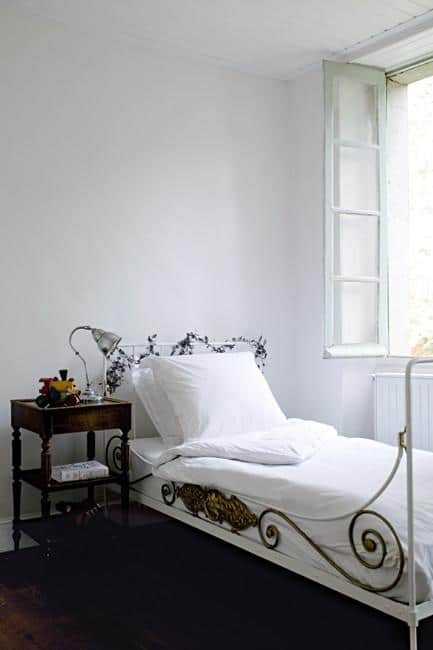 Old and vintage wrought iron bed - Rustic French Country Home Interior Design in Paris