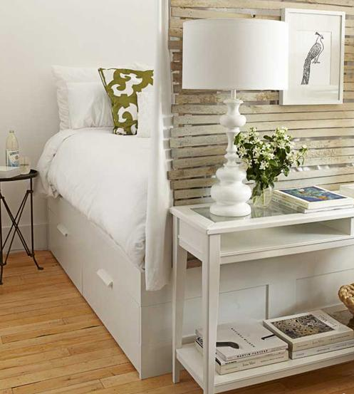 Small white bedroom with cupboard in front of it and a lamp on the cupboard - Small Room Ideas - Interior Design and Decoration