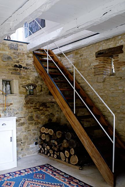 Vintage wooden staircase with metal parapet - Rustic French Country Home Interior