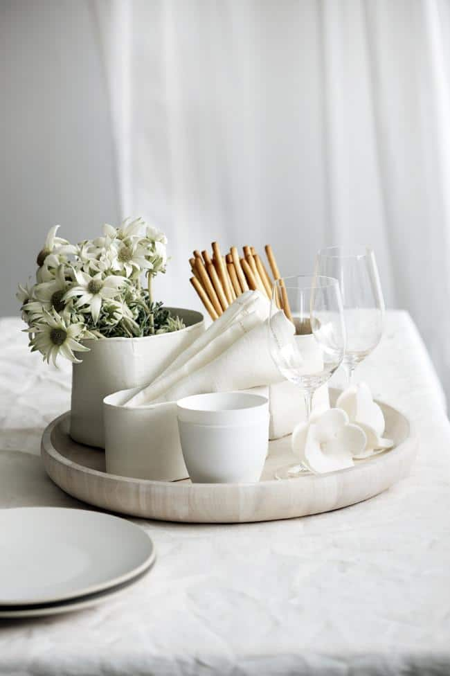 White flowers, cups and napkins on a table - How to Decorate Your Table for Lunch - Tips