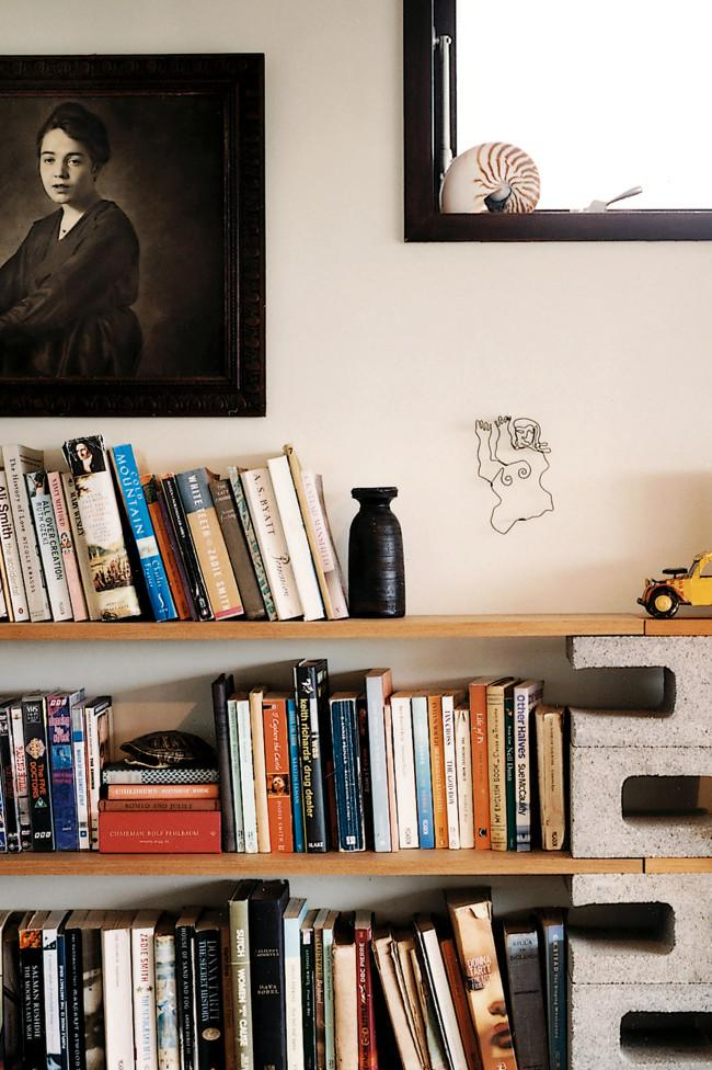 Wooden bookshelves and a wall portrait- Amazing Home Decorating Style Trends and Ideas