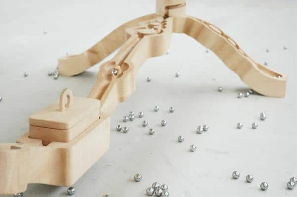 Wooden carvings in the table legs allow the children to play - Unique and Exciting Creative Design of a Wooden Table