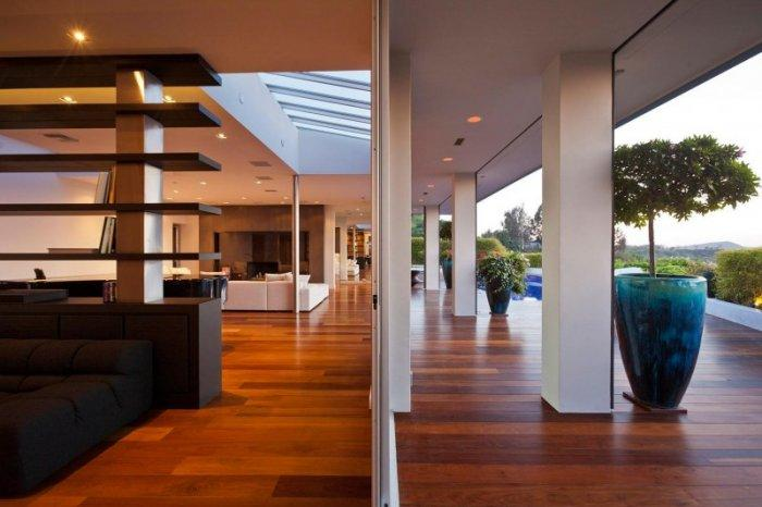 The boundary between the living areas and the wooden deck outside - A Home in Beverly Hills - Stunning One Story House