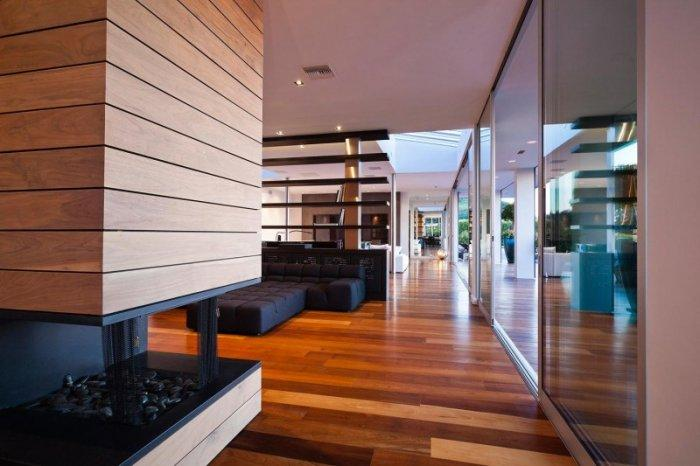 Contemporary fireplace with wooden facing - A Home in Beverly Hills - Stunning One Story House