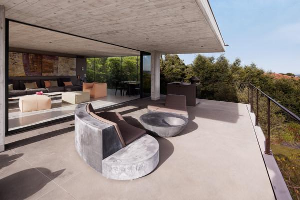 Contemporary terrace with concrete floor tiles - Architecture of a French Luxury House