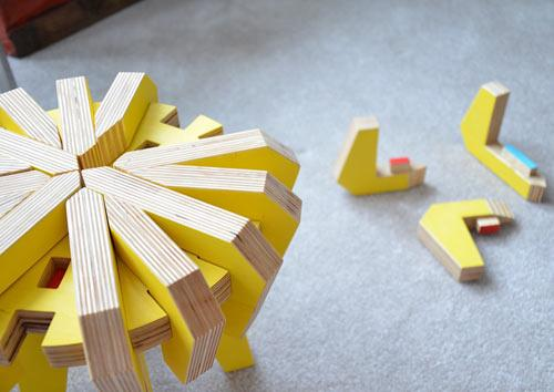 Creative yellow puzzle stool for a contemporary home