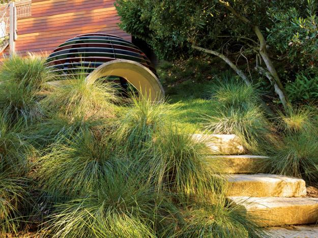 Garden stone stairs leading to a playground installation - 8 Trendy Garden Ideas for Eating, Playing and Relaxing