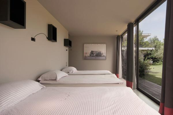 The guest bedrooms are designed with French windows - Contemporary Architecture