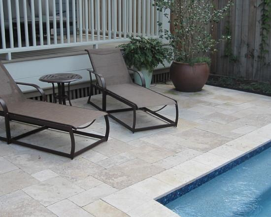 Lounge chairs at a swimming pool - How to Place a Garden Swimming Pool in a Small Yard
