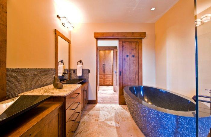 Rustic bathroom design in Eclectic Luxury Weekend Getaway nested in the Canada