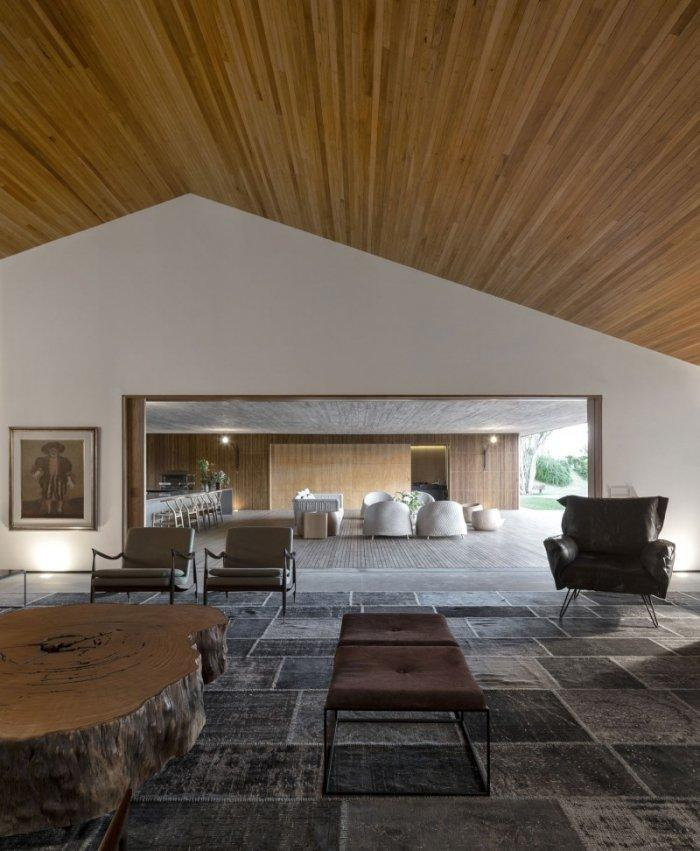 Luxury spacious living room areas in warm brown colors in a house in Brazil