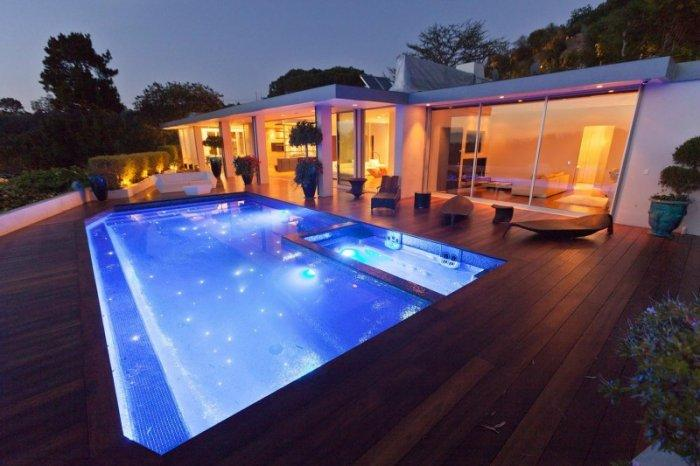 Luxury swimming pool by night - A Home in Beverly Hills - Stunning One Story House