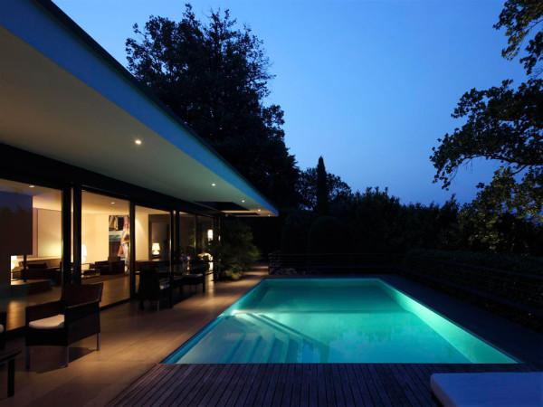 Luxury villa with swimming pool by night - Minimalist Design by Bruno Klauser