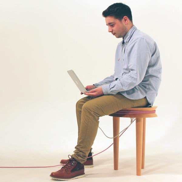 Man sitting on a wooden stool - Transformable Wooden Chair Design - A Creative Idea by Joe Levy