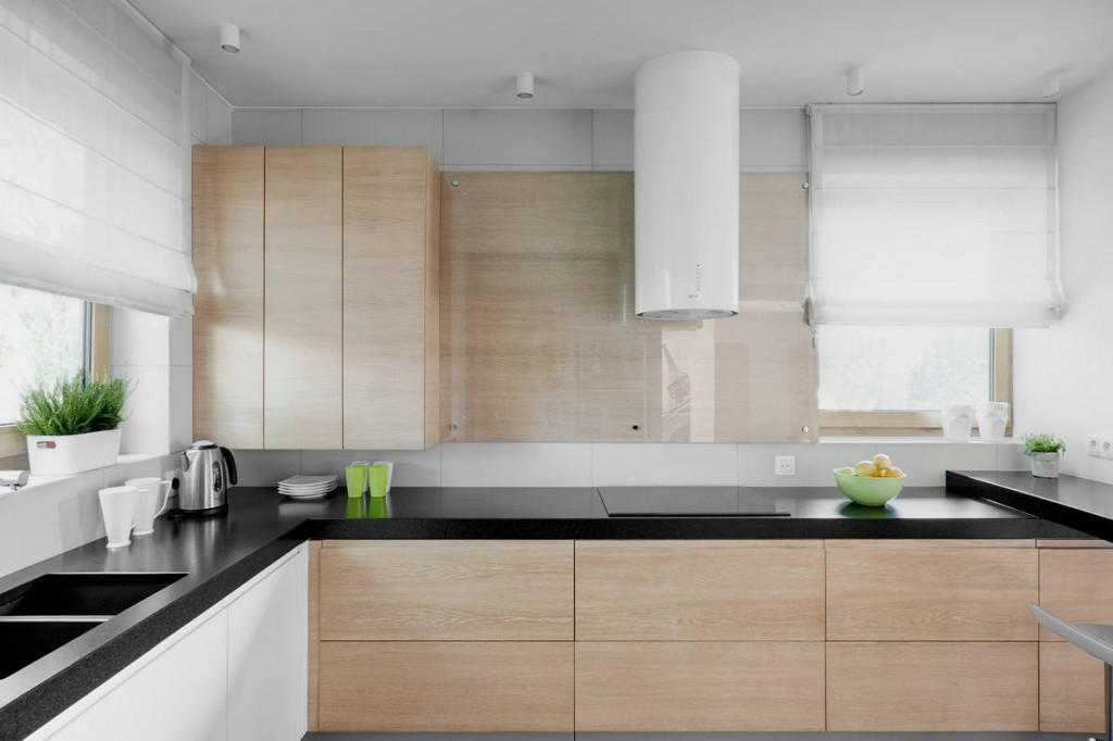 Minimalist kitchen design with wooden cabinets - Contemporary Family House in Poland with Minimalist Touch